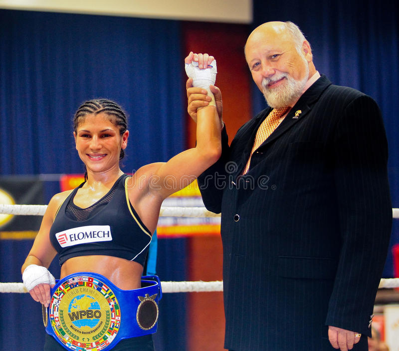 Charity Boxing 2009. VIENNA, AUSTRIA - OCTOBER 3 Charity Boxing: Nadia Raoui and FVA president Willibald Palatin after her fly weight fight on October 3, 2009 in stock images