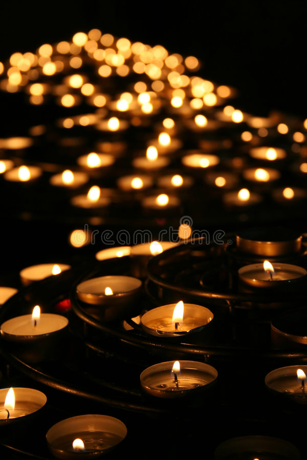 Charity. Praying candles in a temple. stock photos