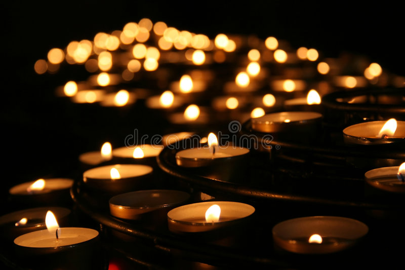 Charity. Praying candles in a temple. royalty free stock photo
