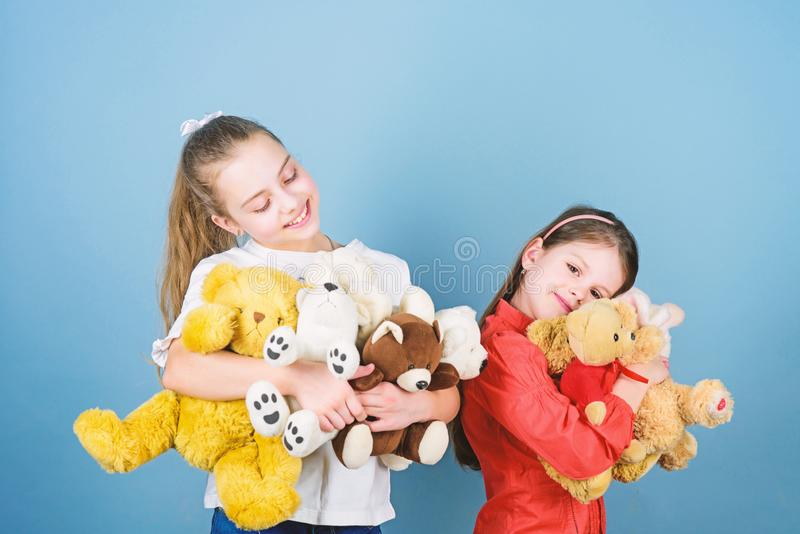 Charity sale. Love and friendship. Kids adorable cute girls play soft toys. Happy childhood. Child care. Sisters best. Friends play. Sweet childhood. Childhood royalty free stock images
