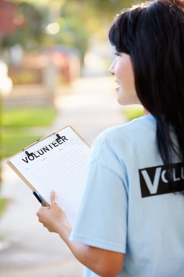 Charity Volunteer At Work On Street. Rear View Charity Volunteer At Work On Street stock photography