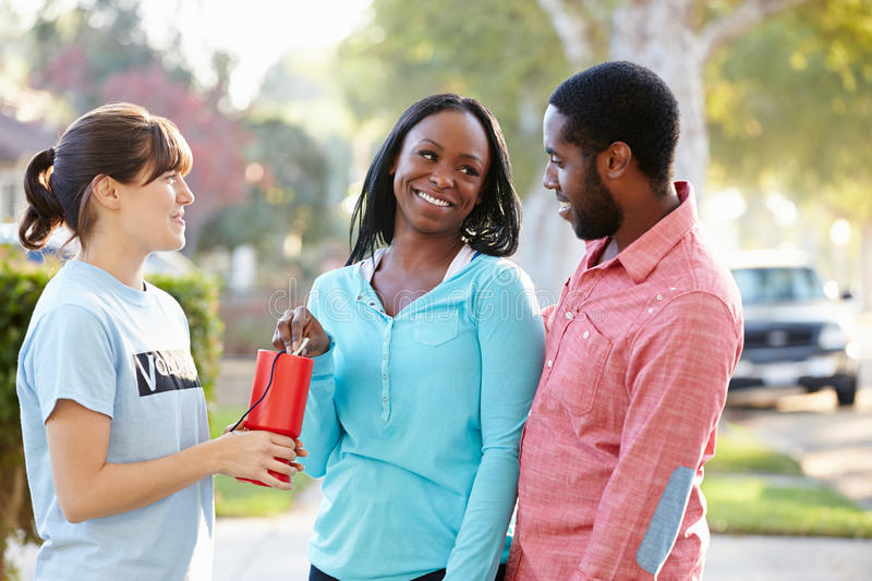 Download Charity Worker Collecting Sponsorship From Couple In Street Stock Image - Image of outdoors, collection: 31350689
