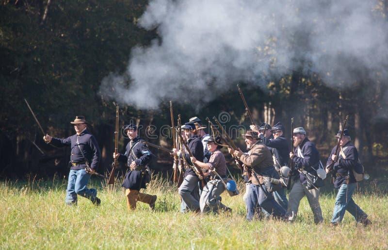 Charging Civil War Battle Reenactors in Union Uniforms. MCCONNELLS, SC USA - November 3, 2018: Reenactors in Union uniforms charge in a recreation of the stock photography