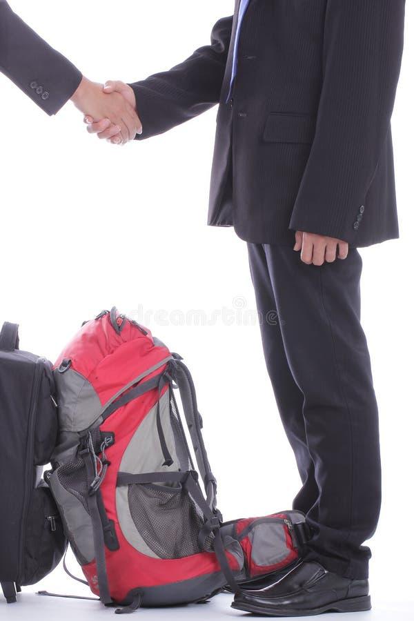Charla del hombre de negocios de la mochila foto de archivo