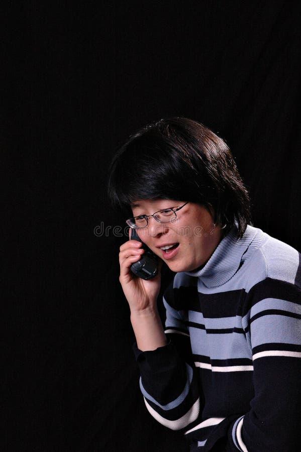 Charla en el teléfono imagen de archivo