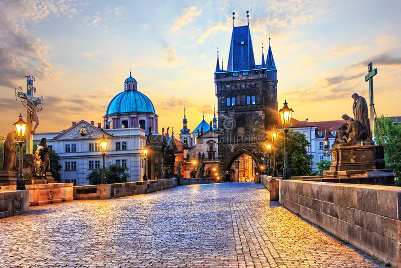 Charles Bridge and Old Town Bridge Tower in Prague at sunrise stock photo