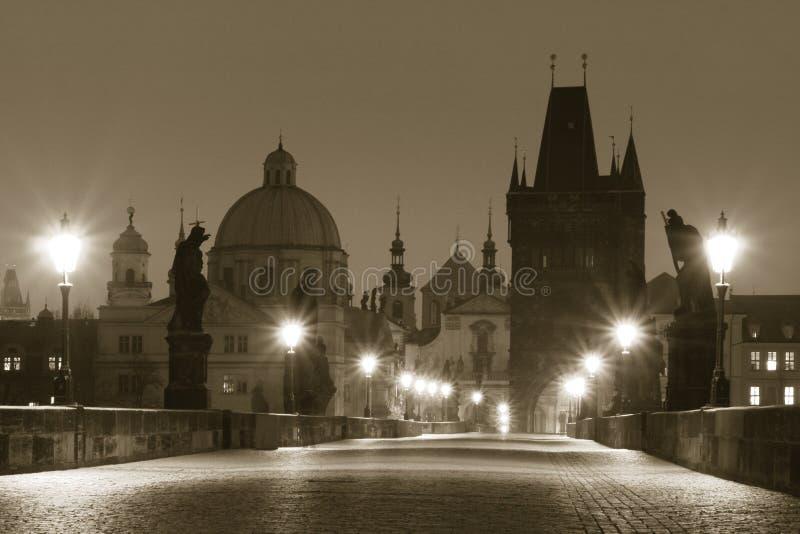 Charles Bridge (Prague). Prague - Charles Bridge in Early Morning (sepia shading royalty free stock photos