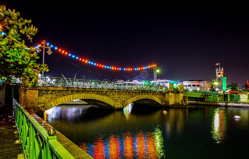 The Chamberlain Swing bridge and Parliament buildings in Bridgetown, Barbados at Christmas and Independence. Late Christmas evening in brightly lit Bridgetown stock image