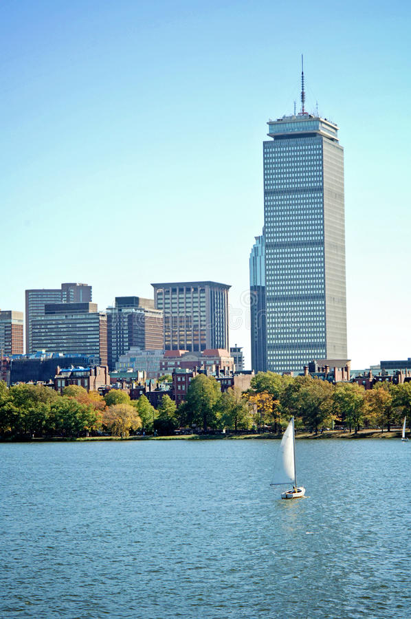 Charles River Boston. A view of Boston and the Charles river with a sailboat on a fall day royalty free stock photography