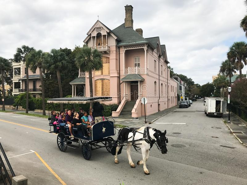 Charleston Prepares for a Hurricane. Homeowners in downtown Charleston take precautions to their homes from from strong winds of Hurricane Irma. Tourists still stock photos