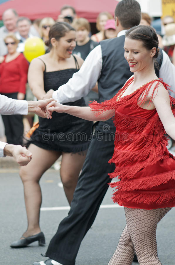 Charleston Street Dancing. Street Dancing in Brisbane during the Racecourse Road Carnival, 5 June 2011; demonstration of swing, lindy hop and charleston by the royalty free stock photography