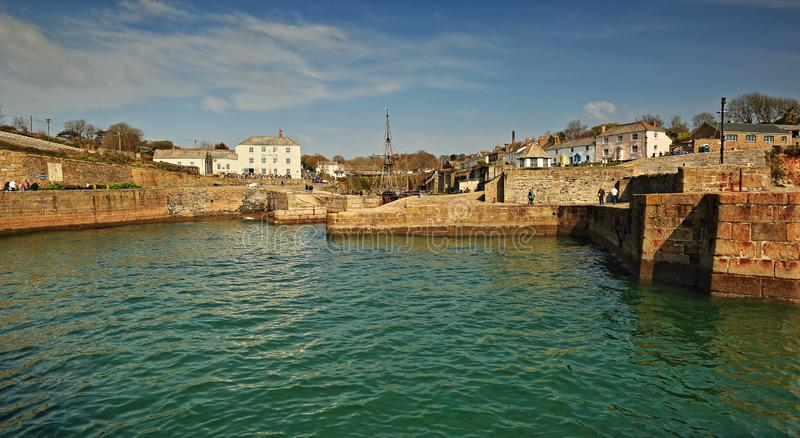 Charlestown Harbour, Cornwall. Blue skies above the harbour and quayside at high tide in  Charlestown, Cornwall royalty free stock photos