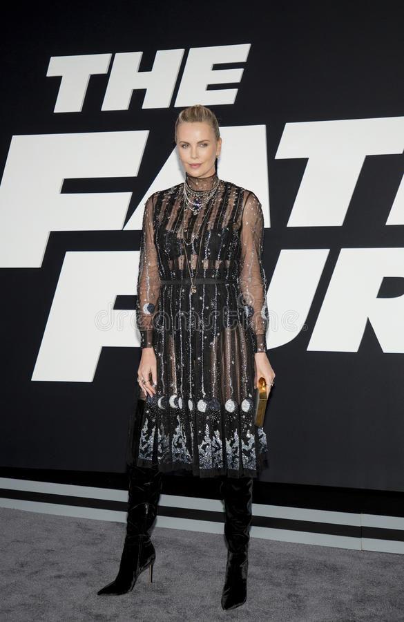 Charlize Theron. Gorgeous South African Oscar-winning actress Charlize Theron arrives on the red carpet for the New York City premiere of `The Fate of the stock images