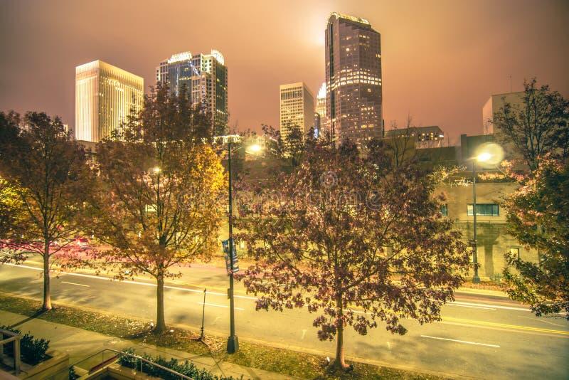 Charlotte City Skyline night scene with light rail system lynx t. Rain stock photography