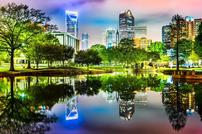 Charlotte, NC skyline reflected in Marshall Park pond. On a foggy night royalty free stock images