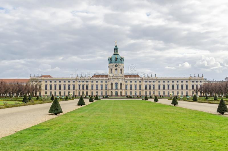Charlottenburg Palace in Berlin with its large formal garden. Berlin, Germany - March 19, 2019: Charlottenburg Palace with its domed tower, a wind vane in the royalty free stock photography