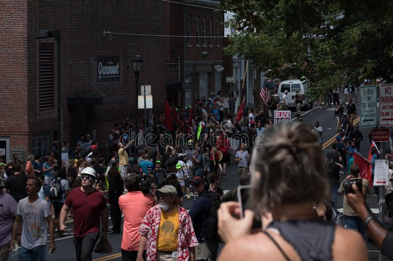 Unite The Right Riot 12:05 pm. Charlottesville, Virginia USA August 12, 2017 Crowd surges down Market Street after rally was dispersed when violence broke out royalty free stock photography