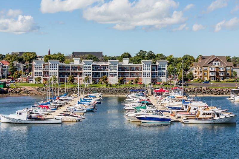 Charlottetown Marina Apartments. Fishing boats in harbor of Charlottetown, Prince Edward Island stock photo