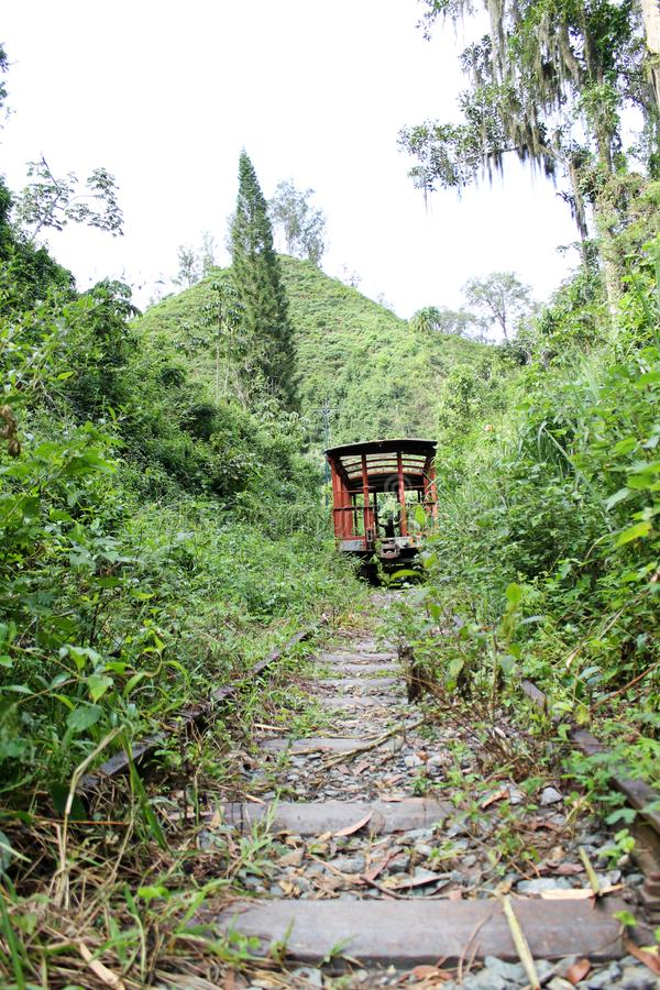 Charm train. One of the abandoned trains in Los Teques, Venezuela. Towards the station El Encanto stock photography