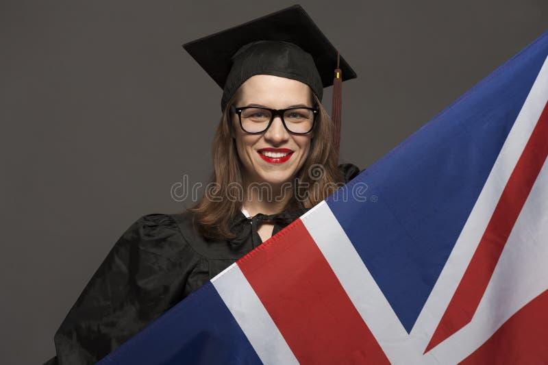 Charma den kvinnliga studenten som ler i glas?gon som b?r det svarta ansvaret arkivfoto