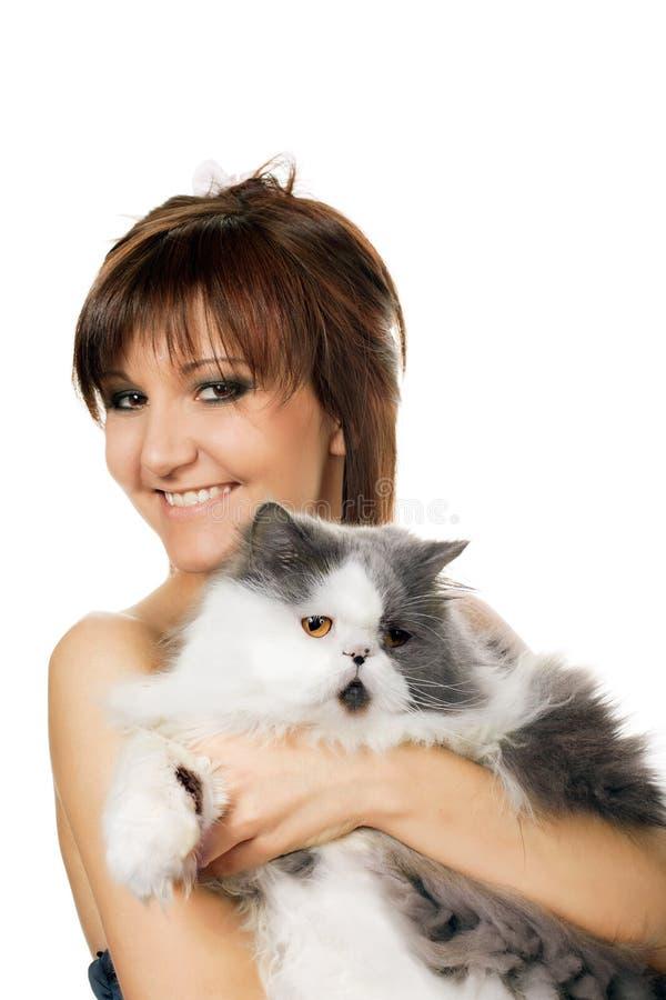 Charmante jonge vrouw en kat royalty-vrije stock afbeeldingen