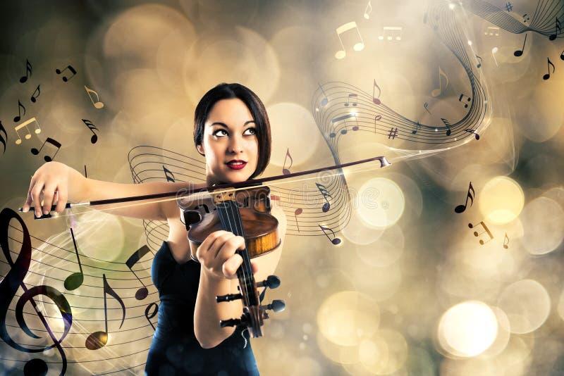 Charmig violinist fotografering för bildbyråer