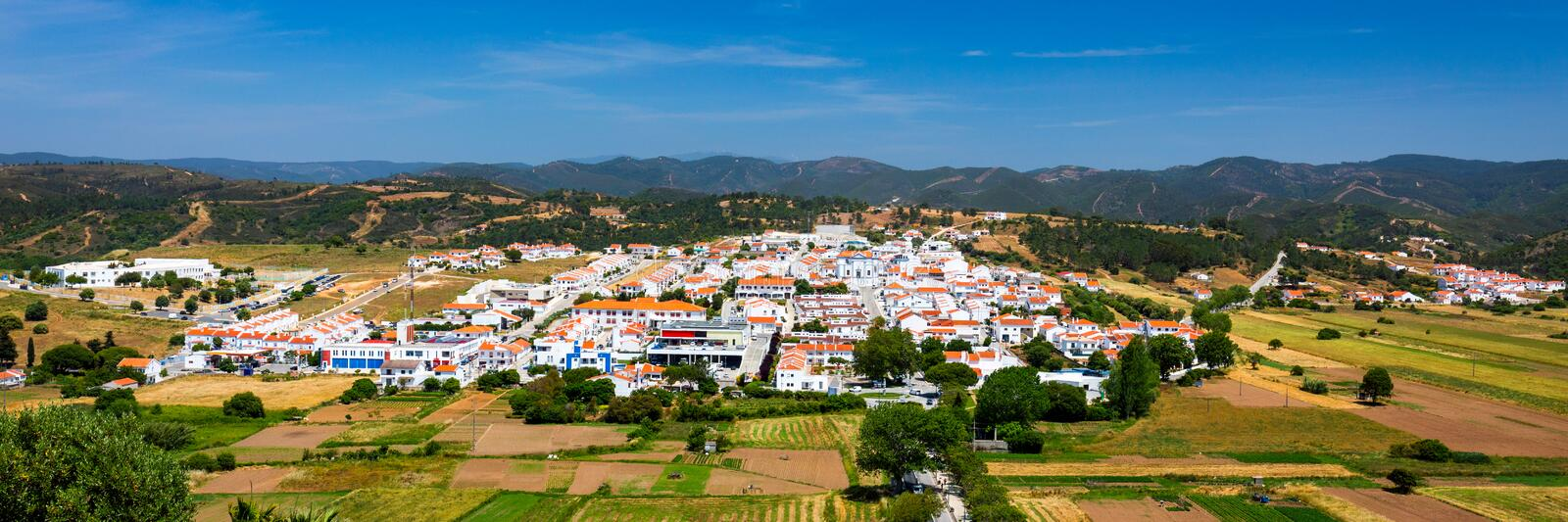 Charming architecture of hilly Aljezur, Algarve, Portugal. View to the small town of Aljezur with traditional portuguese houses royalty free stock images