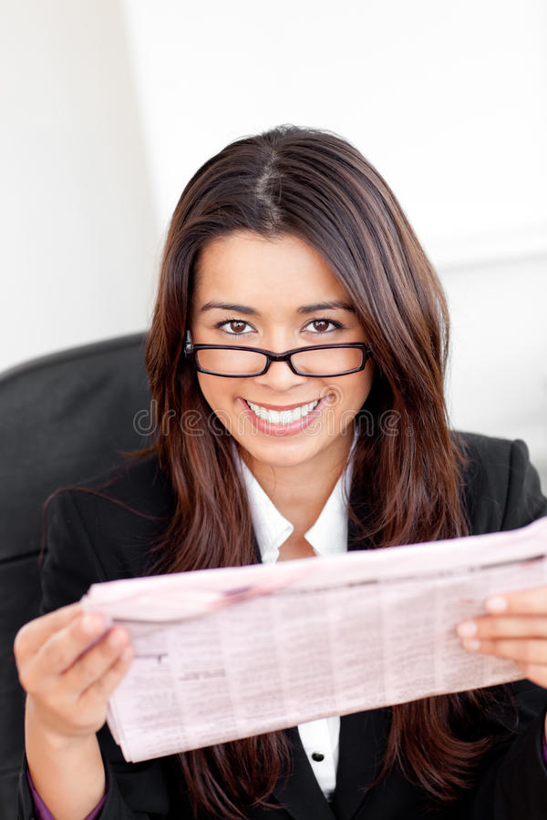 Download Charming Asian Businesswoman Holding A Newspaper Stock Photo - Image: 15621856