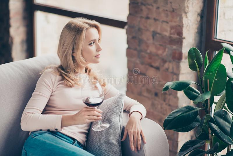 Charming, attractive, pretty, stylish woman, having glass of wine stock images