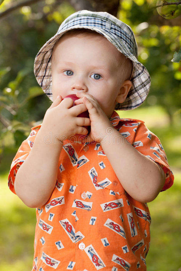 Download Charming Babe Eats Delicious Apple Stock Image - Image: 26141993