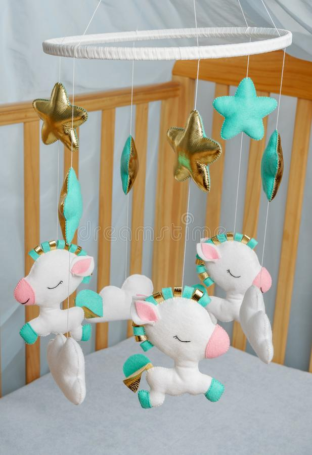 Charming baby crib mobile - kids toys,made from felt.Children`s sweet dream royalty free stock photography