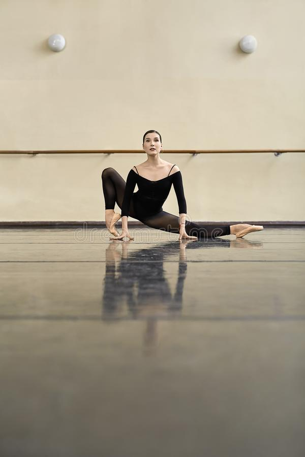 Ballerina posing in dance hall stock images
