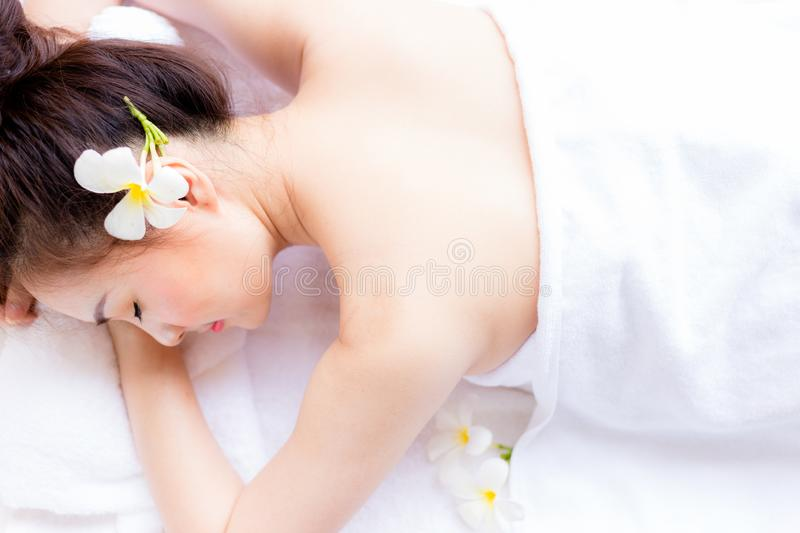 Charming beautiful customer woman is lying down on bed. Attractive beautiful woman is sleeping at resort, luxury hotel, spa shop. Gorgeous girl feel relaxed royalty free stock image