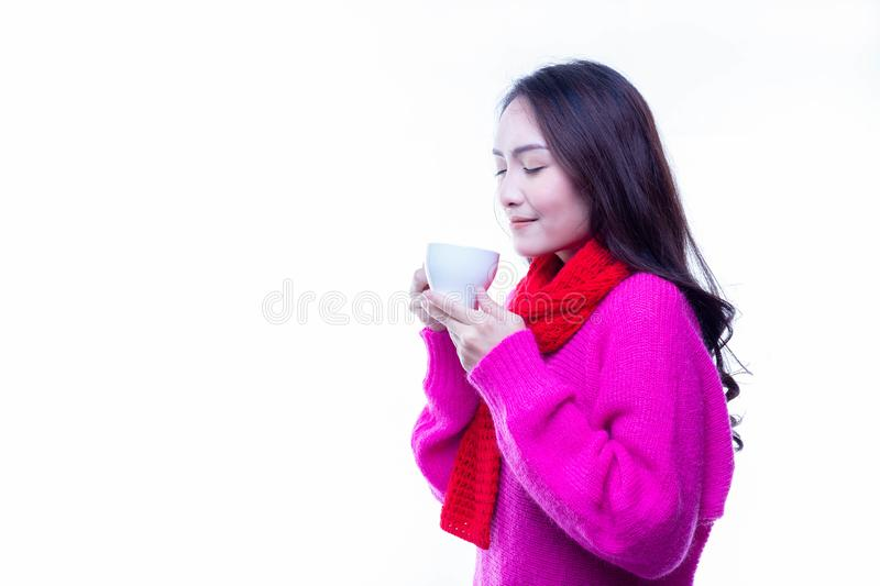 Charming beautiful woman drinks hot coffee or tea in winter seas royalty free stock images