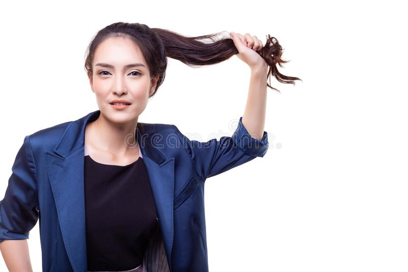 Charming beautiful woman is pulling her long hair for proving th stock photos