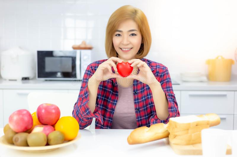 Charming beautiful woman is showing the heart, feel happy. Attractive beautiful woman has good health by taking care herself well stock photography
