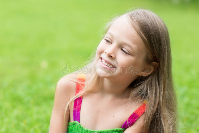 Charming blond girl looking to the side royalty free stock image