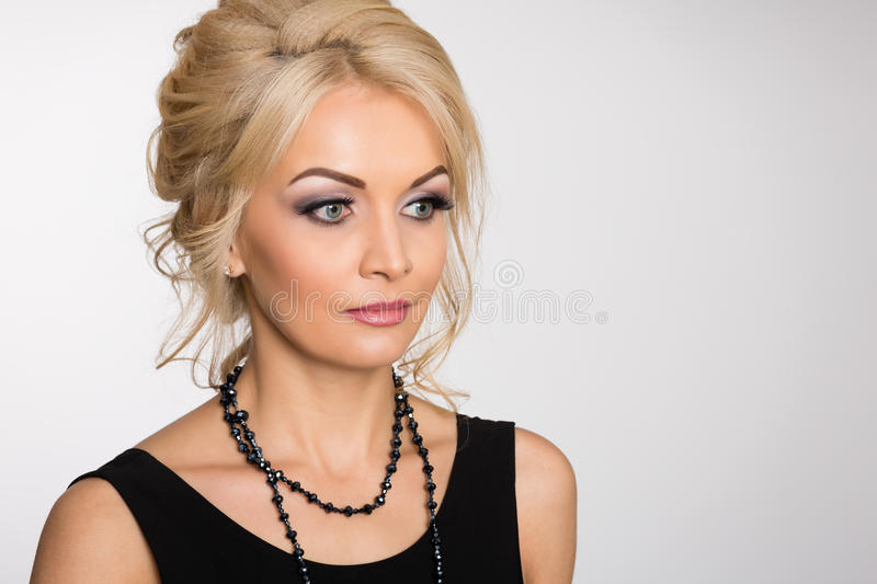 Charming blonde with a stylish hairstyle royalty free stock photo