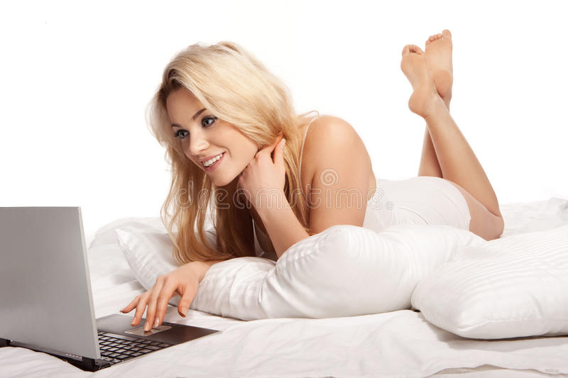 Charming blonde woman using a laptop