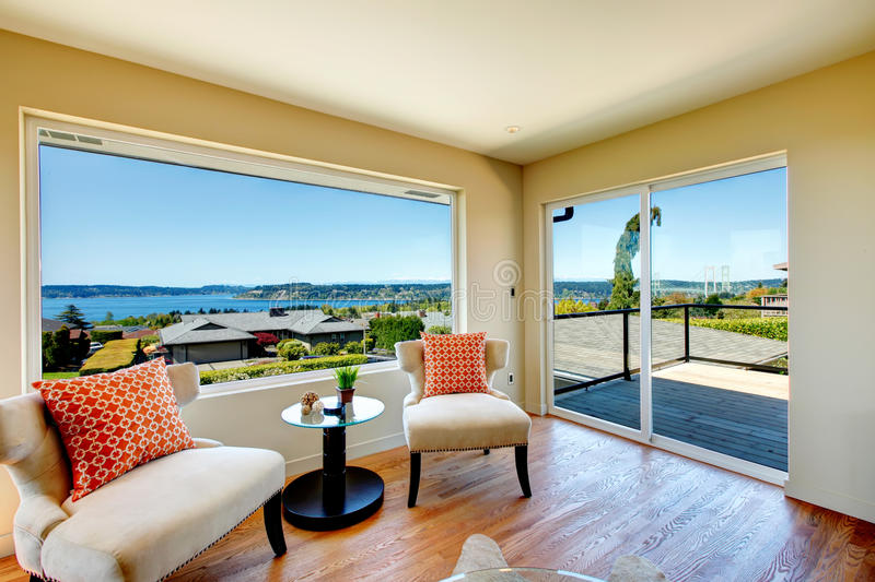 Charming bright living room with walkout deck and amazing window royalty free stock photography