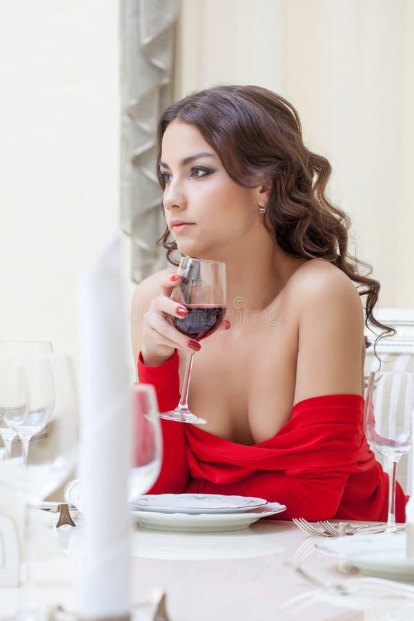 Free Charming Brunette Drinking Wine In Restaurant Stock Images - 31677254