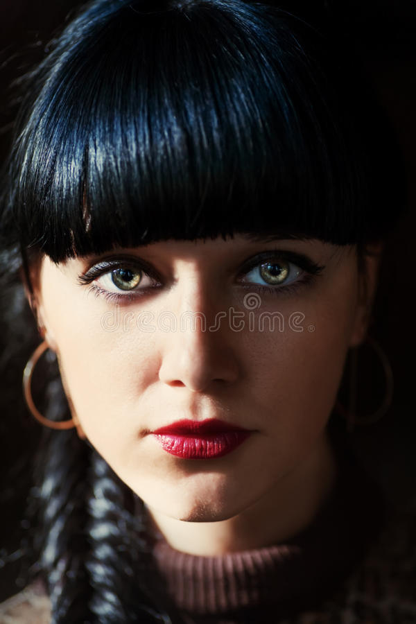 Charming brunette paranormal look, shadow of light and dark stock images