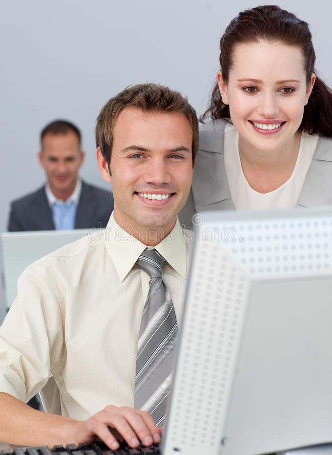 Download Charming Businesswoman Helping Her Colleague Stock Image - Image: 12715839