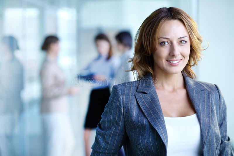 Charming businesswoman. Image of pretty businesswoman looking at camera stock photo