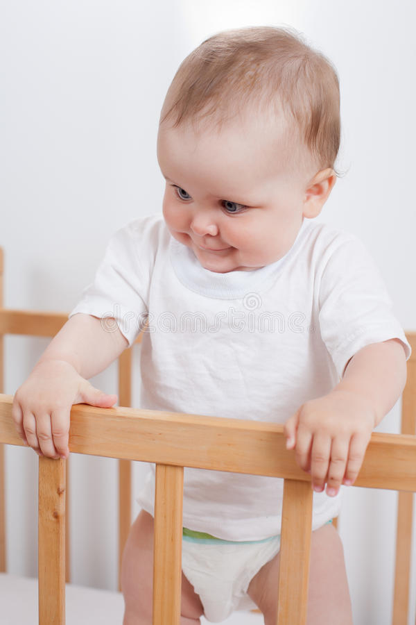 Charming child in the crib stock image