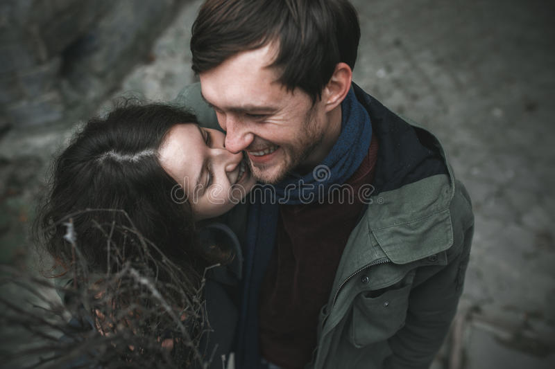 Charming couple in a dress walking down the street stock photography