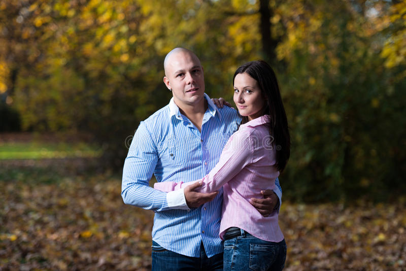 Charming Couple Standing Together At The Park royalty free stock images