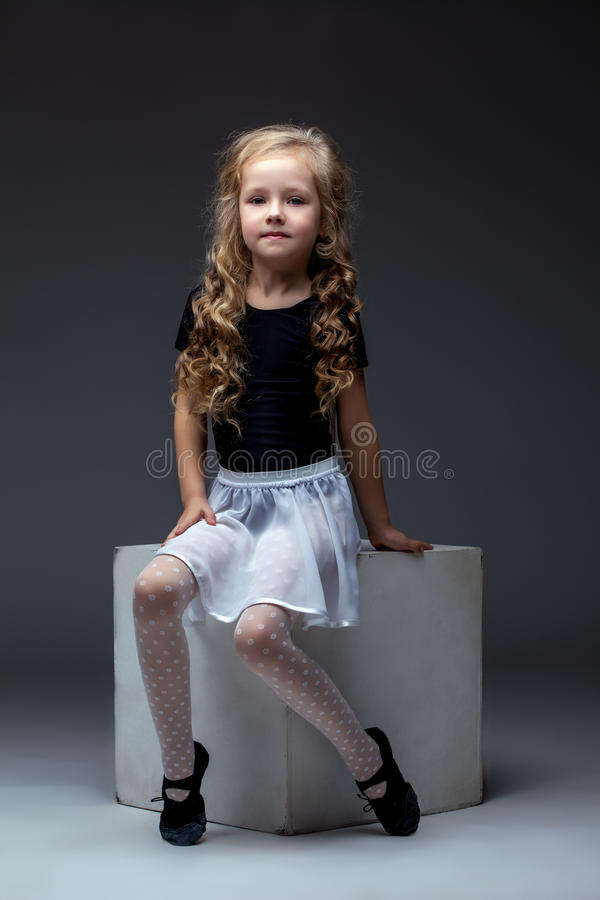 Charming curly performer posing in studio stock photography