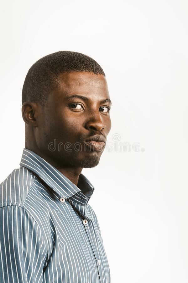 Free Charming Dark-skinned Guy Makes Duck Lips Looking At Camera. Young African American Handsome Man Isolated On White Royalty Free Stock Photo - 184921575