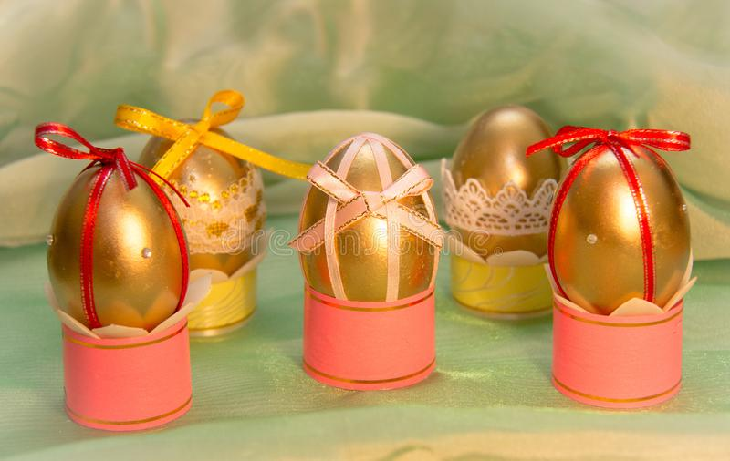 Charming Easter eggs on the legs with bows stock photos